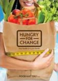 "A smiling woman holds a paper grocery bag filled with fresh food. The title says, ""Hungry for Change."""