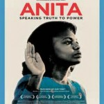 Image of Anita Hill raising her hand