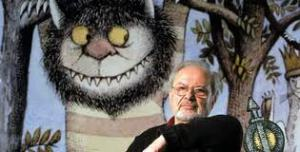 Photograph from PBS.org of Maurice Sendak with a picture of one of the creatures from Where the Wild Things Are behind him