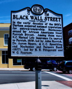 Photo of a historical sign with information about Black Wall Street