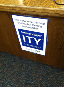 photo of a sign at the library front desk advertising the new Interpretype services