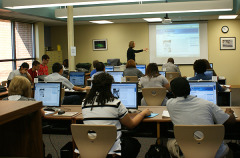 Photograph of a librarian teaching a class in the library
