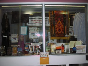 Photograph of the main campus library display window showing materials from the Muslim Journeys