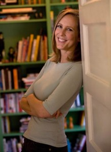 Author Mary Roach leans in a doorway