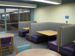 A photograph showing the booths in the downstairs study area of the library