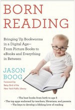 Shows a young child with glasses and a book open in front of him