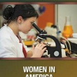 A woman looking into a microscope