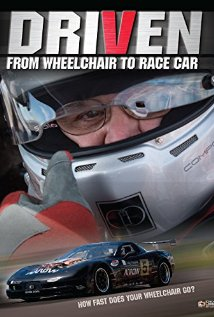 Driven: From Wheelchair to Racecar. A blue racecar in front of a man in a racing helmet giving a thumbs up.