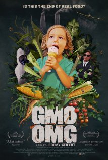 GMO OMG. A girl eating ice cream with vegetables and sinister looking men in the background.