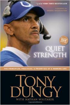 Tony Dungy looking into the distance.