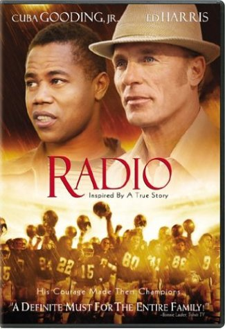 Cuba Gooding, Jr and Ed Harris staring above a triumphant football team.
