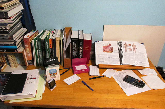 anatomy and science textbooks on a desk